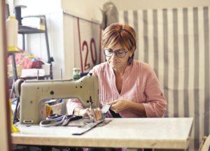photo-of-woman-using-sewing-machine-3811855